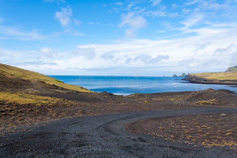 Vestmannaeyjar island beach day view, Iceland landscape stock photo