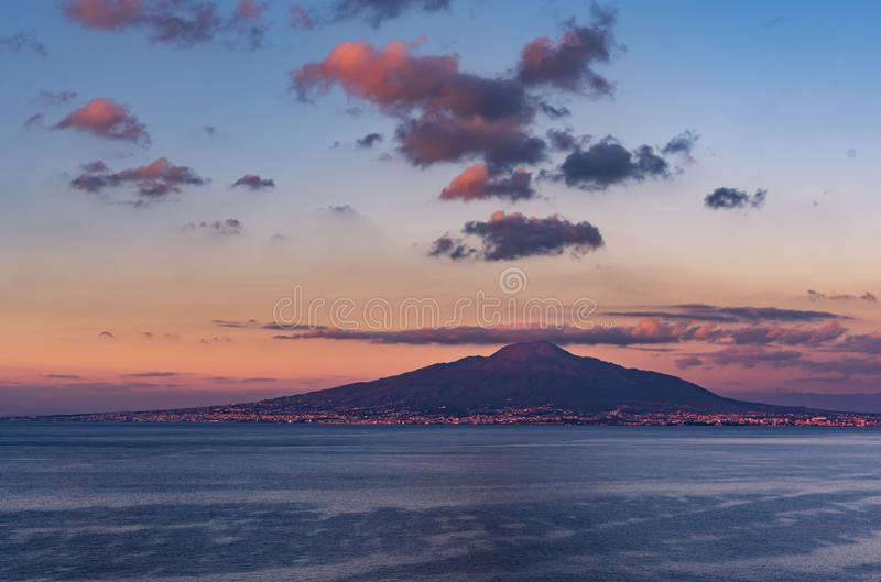 Vesuvio volcano and Naples with a cloudy sky at the sunset. Giving an incredible 3D effect royalty free stock image