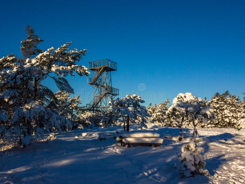 Vetatoppen, viewpoint tower in Fredrikstad, Norway. Winter, sun, snow. Vetatoppen, viewpoint tower in Fredrikstad, Norway. Winter sun snow and blue sky stock images