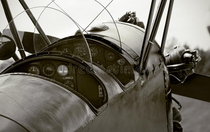 Veteran airplane cockpit. Cockpit of the double wing veteran aircraft royalty free stock photo