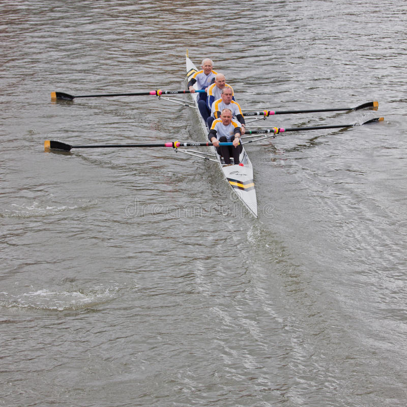 Veteran Competitors. BRISTOL, ENGLAND - FEBRUARY 19: Veteran crew pulling in harmony during the annual Head of the River event in Bristol, England on February 19 stock image