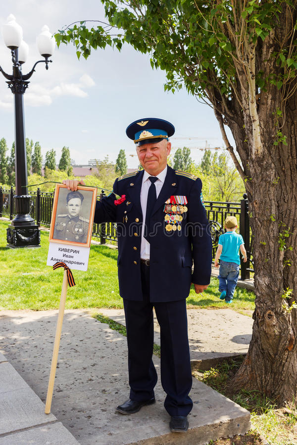 The veteran of the Great Patriotic War with medals. VOLGOGRAD, RUSSIA - May 09, 2016: The smiling veteran of the Great Patriotic War (World War II) of the Second stock photos