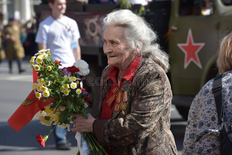 Veteran with medals victory parade on May 9. Petersburg, Russia stock photo
