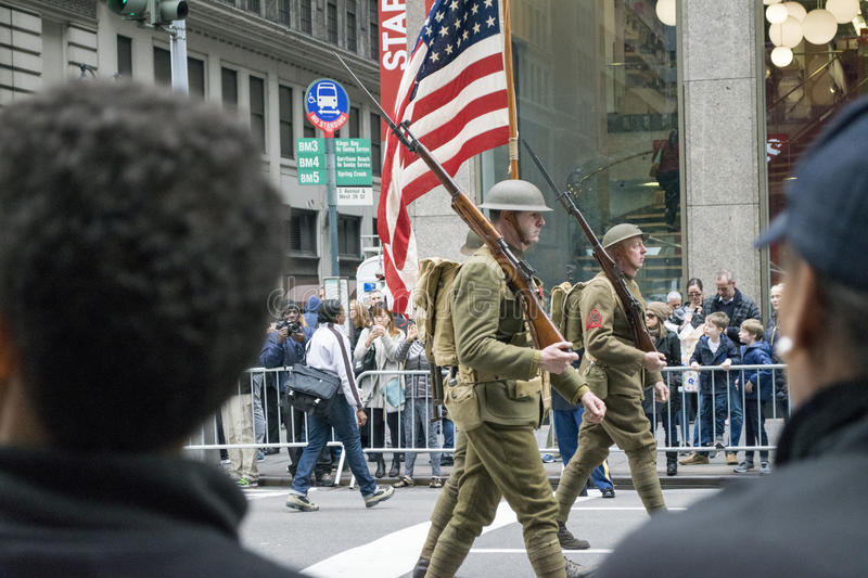 Veterans Day Parade NYC. Marchers dressed as World War I soldiers march in the New York City Veterans Day parade stock photo