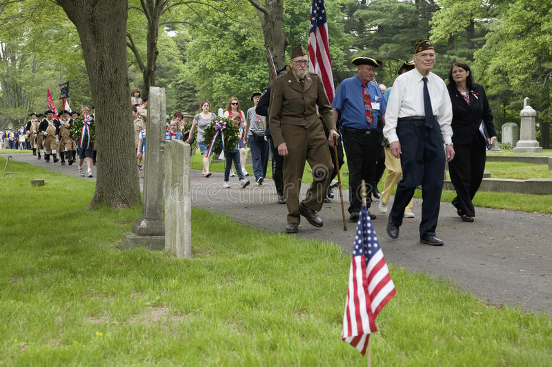 Veterans march on Memorial day. Historic Lexington Cemetery on Memorial Day, 2011 where Veterans honor fallen soldiers, MA stock photo