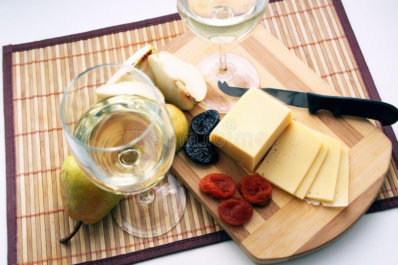Vetri con vino bianco fotografia stock