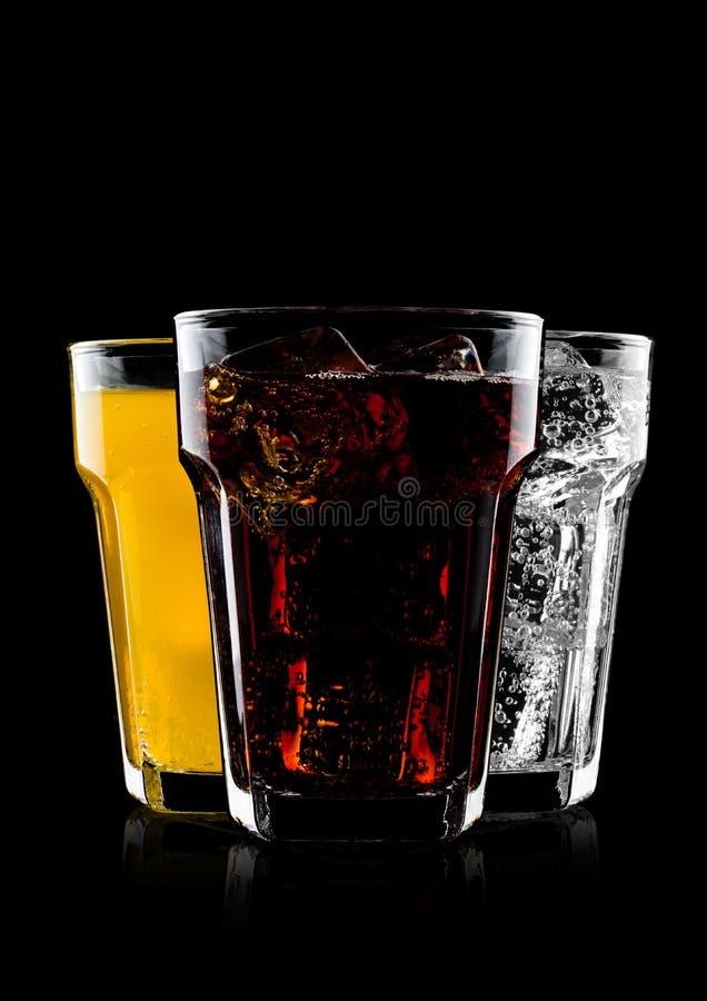 Vetri di cola e della bevanda e della limonata della soda arancio immagine stock
