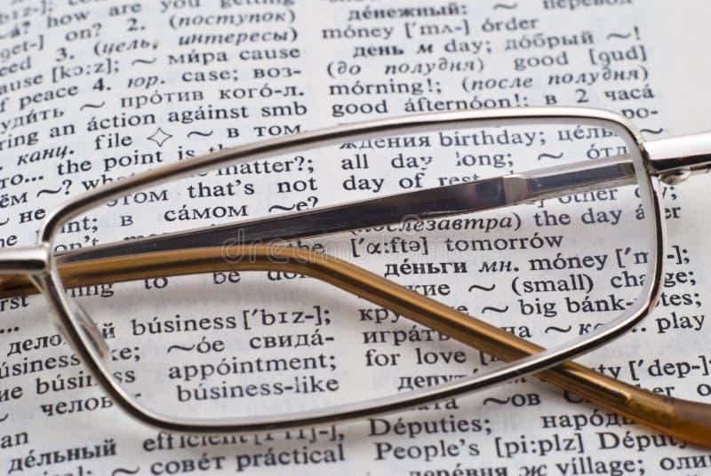 Vetri e dizionario fotografia stock