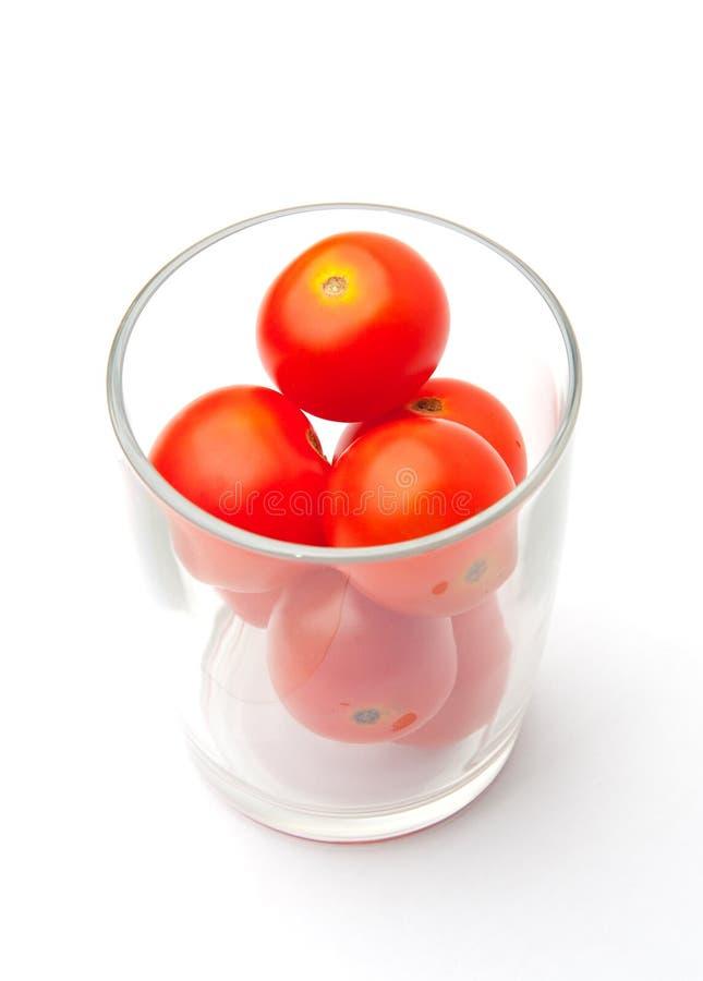 Vetro dei pomodori di ciliegia immagine stock libera da diritti
