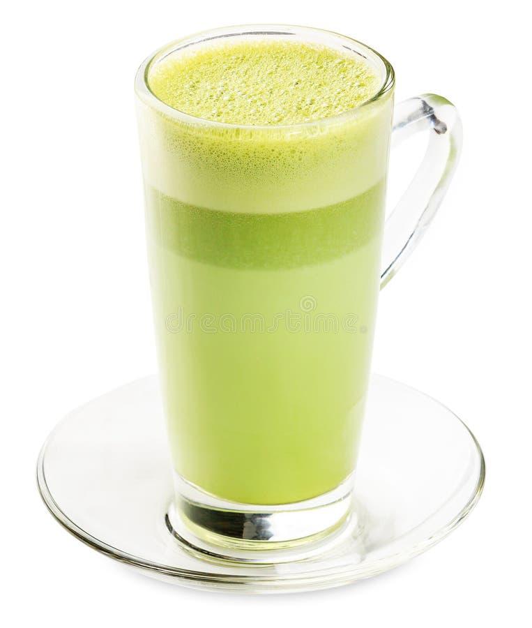 Vetro del frullato del tè verde isolato su fondo bianco fotografia stock