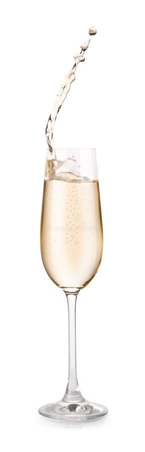 Vetro di champagne con spruzzata immagine stock libera da diritti