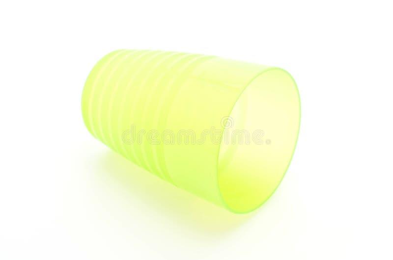 Vetro di plastica verde immagine stock