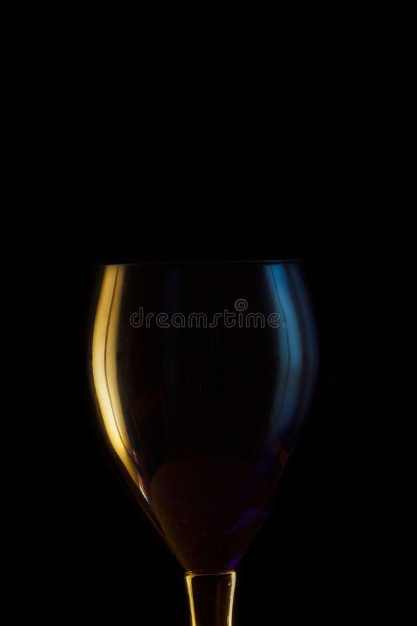 Vetro di vino acceso lato fotografia stock libera da diritti