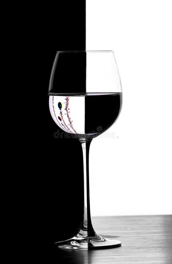 Vetro di vino del christmad di domino fotografia stock libera da diritti
