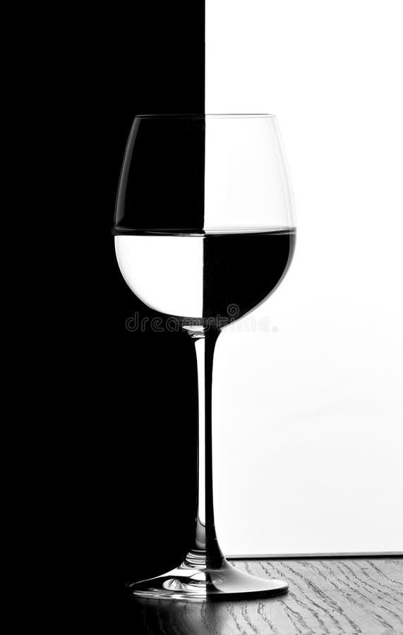 Vetro di vino di domino fotografia stock