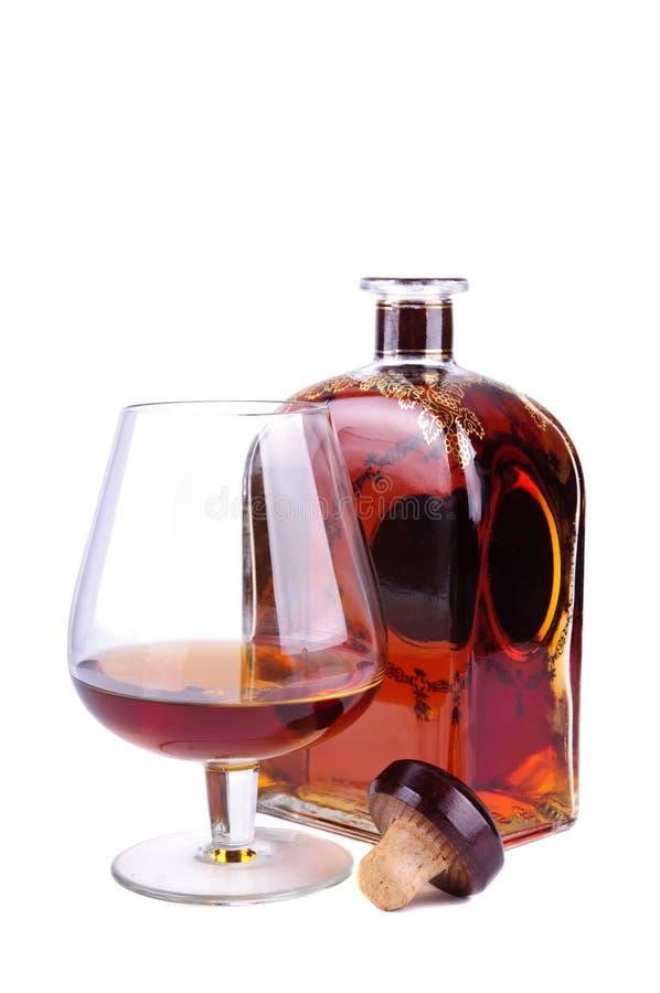 Vetro e bottiglia del cognac immagine stock libera da diritti