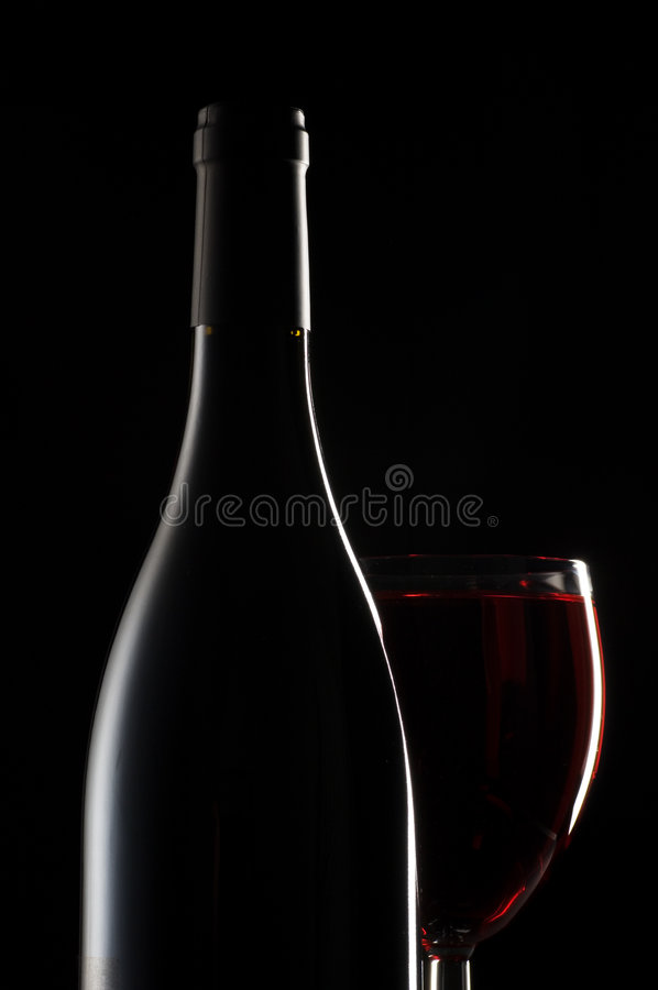 Vetro e bottiglia di vino fotografia stock
