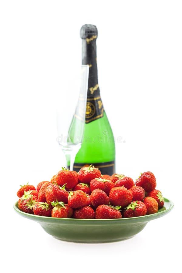 Vetro e fragole di Champagne fotografia stock