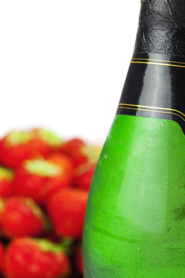 Vetro e fragole di Champagne immagini stock