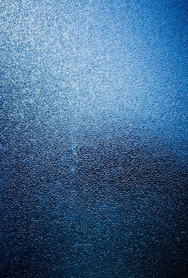Vetro opaco blu con l'illusione del ghiaccio fotografia stock libera da diritti