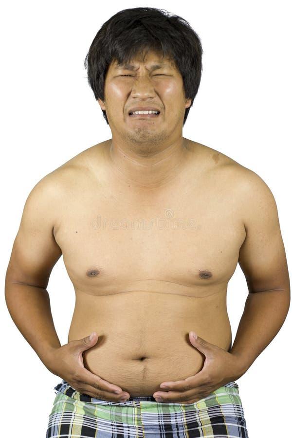 Vette mens wat betreft zijn maag, Vette mens met een grote buik die op witte achtergrond wordt geïsoleerd royalty-vrije stock fotografie