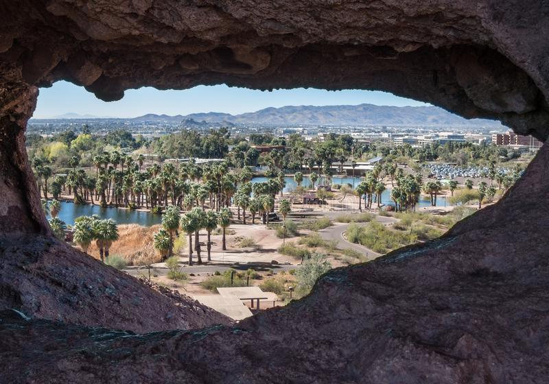 Vew of Scottsdale through Hole in the Rock. Hole in the Rock, Papago Park, Scottsdale, Arizona royalty free stock images