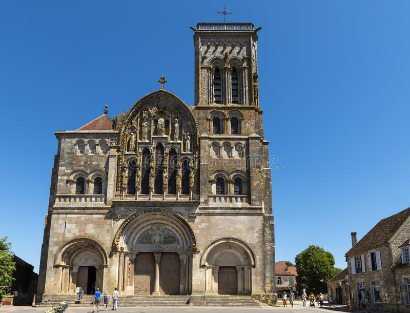 Vezelay Church France. Vezelay, France - July 29, 2018: The front of the romanesque church and abbey of Vezelay in Yonne, France with people, tourists, in front royalty free stock images