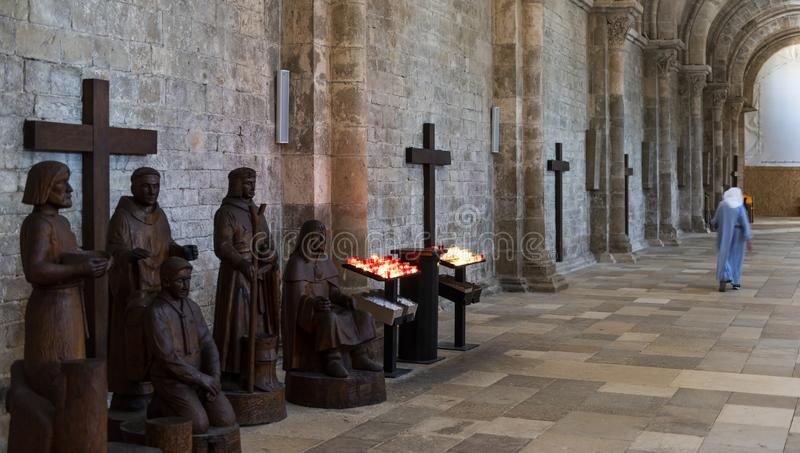 Nun in Church Abbey Vezelay. Vezelay, France - July 29, 2018: Church Interior with nun walking in the romanesque abbey and church of Vezelay in Yonne, France royalty free stock photography