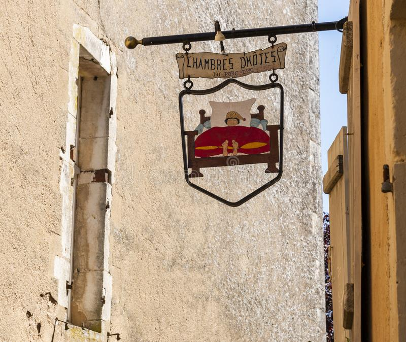 Sign Chambre de Hotes in Vezelay. Vezelay, France - July 29, 2018: Sign with sleeping man in bed at the wall in Vezelay of a b&b or Chambres d`Hotes, Yonne royalty free stock images