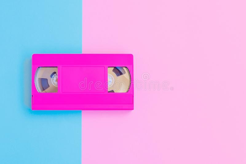 VHS cassette on soft pink and blue paper background. Minimal concept. Creative concept. Cinema concept. Pop Art. royalty free stock photo