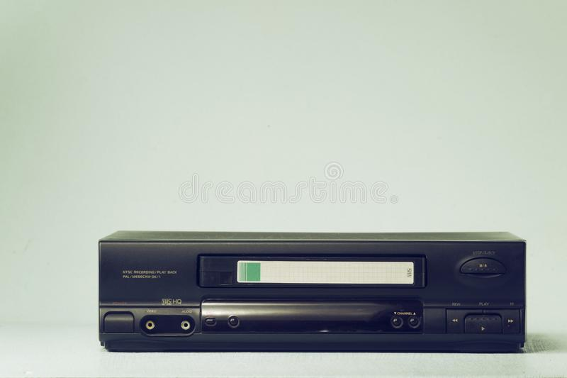 VHS video recorder Retro video recorder with video cassette on a light background film effect stock image