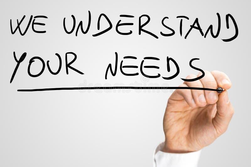 Vi förstår dina behov royaltyfri bild