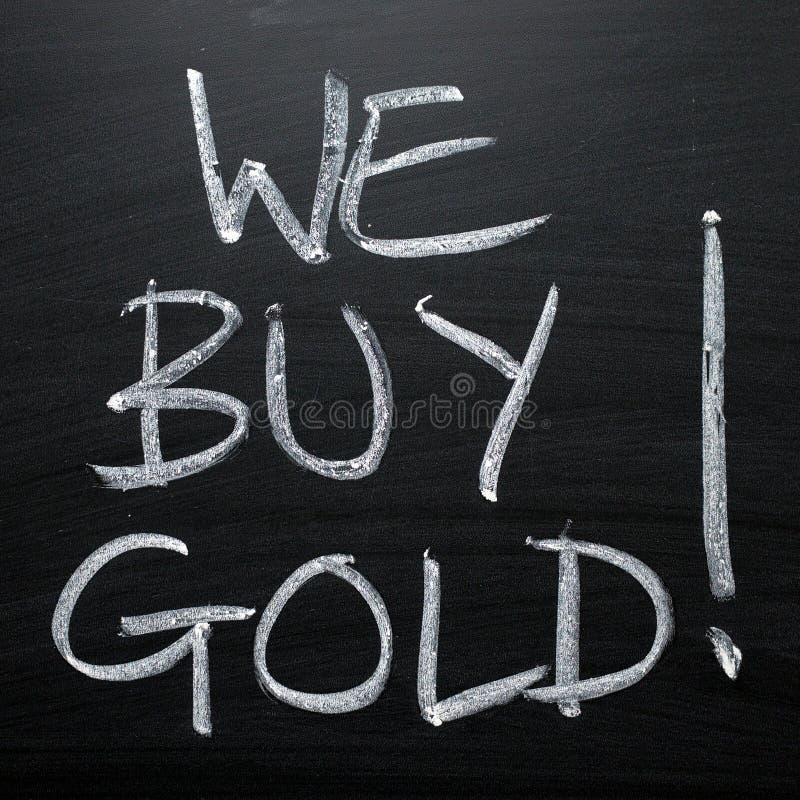 Vi köper det guld- svart tavlatecknet arkivbild