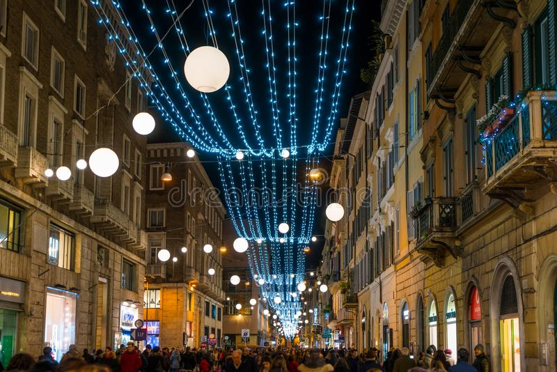 Via del Corso in Rome during Christmas time, Italy. The Via del Corso, is a main street in the historical centre of Rome. It is remarkable for being absolutely stock photography