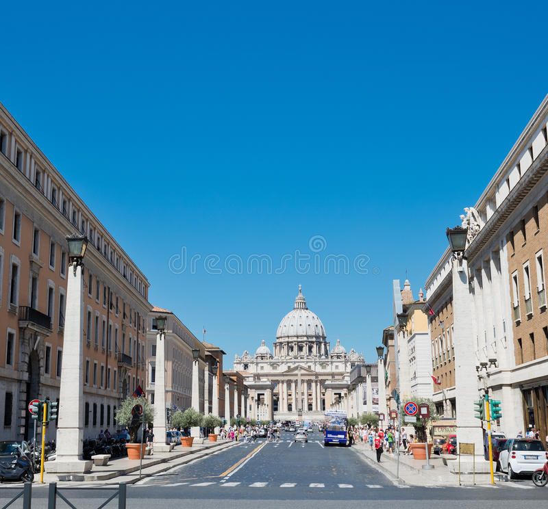Via della Conciliazione in Rome Italy. Urban scene with Via della Conciliazione and Saint Peter Cathedral. ROME, ITALY - JULY 15 2014: Via della Conciliazione in royalty free stock photography