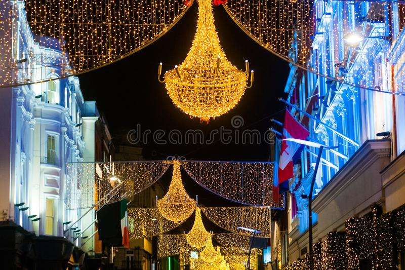 Via di Grafton a Dublino, luce di Natale Il ` di Nollaig Shona Duit del ` dell'iscrizione è ` di Natale felice del ` nell'Irlande immagine stock
