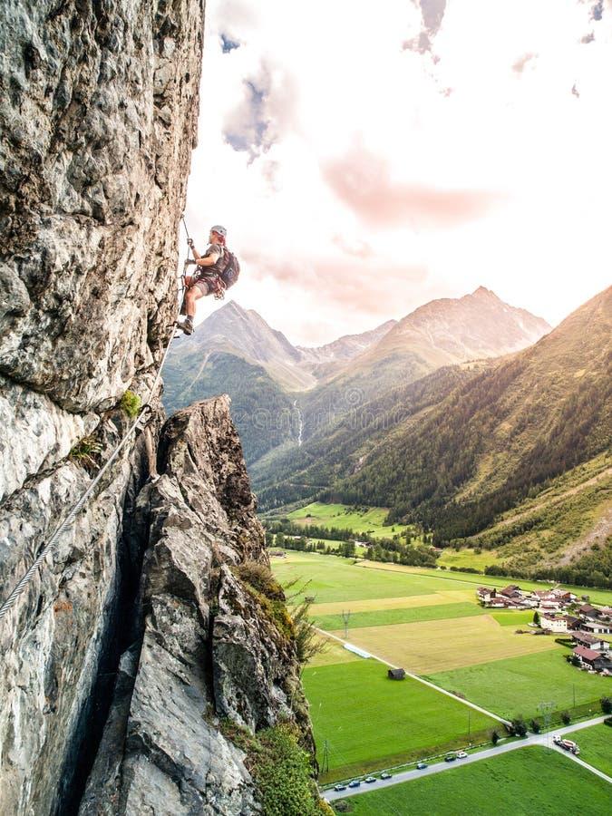 Free Via Ferrata Climber Climbs Vertical Rock, Reinhard Schiestl Klettersteig, Austria Royalty Free Stock Photos - 143191228