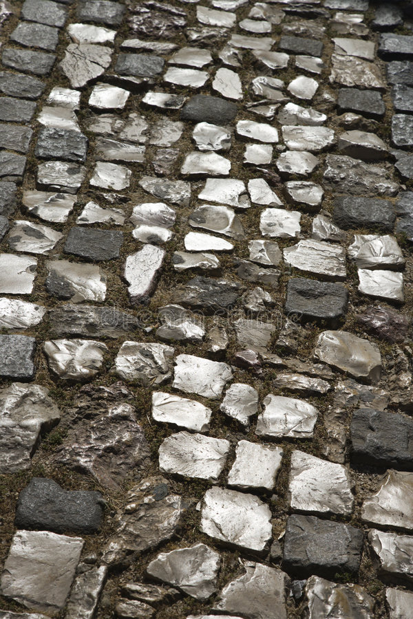 Via inlayed pietra a Lisbona, Portogallo. fotografia stock