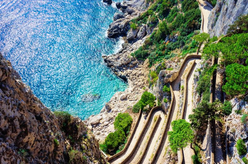 Via Krupp street at Marina Piccola in Capri Island town. Naples, Italy. Landscape with Eoad and Blue Mediterranean Sea at Italian coast. Anacapri in Europe stock photo