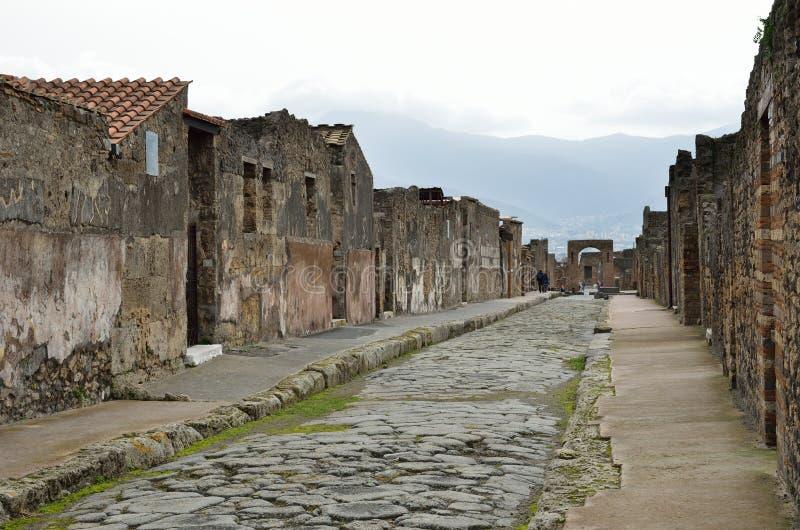 Via ristabilita nella città antica Pompei immagini stock