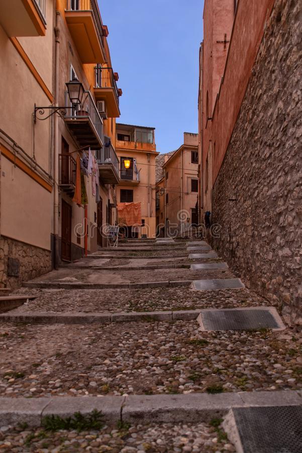 Via San Pietro in the historic district in the upper part. Of Termini Imerese, it is the beginning of via Sant`Orsola in the form of a stone staircase stock photography