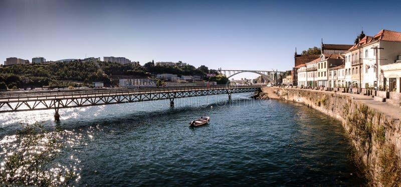 Viaduto do cais das pedras, Porto, Portugal. Viaduto do cais das pedras. Viaduct over the Douro river and traditional old houses in Porto, Portugal stock photo