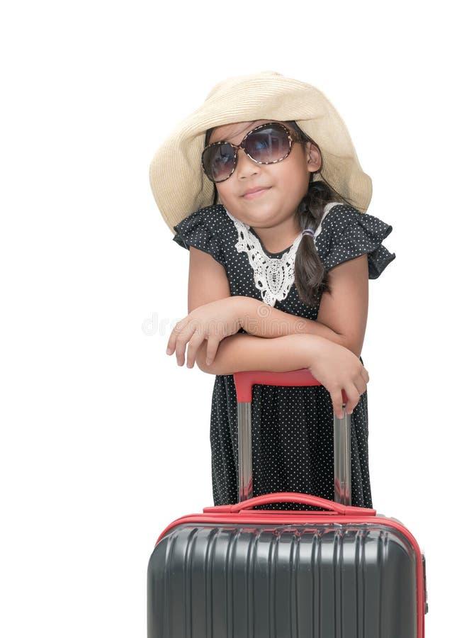 Viajante bonito da menina com a mala de viagem isolada fotos de stock royalty free