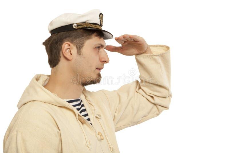 Viaje y concepto marino - hombre en sombrero del capitán foto de archivo