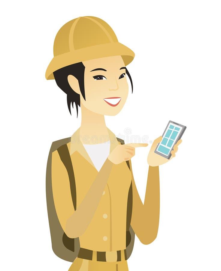 Viajero asiático joven que sostiene un teléfono móvil stock de ilustración