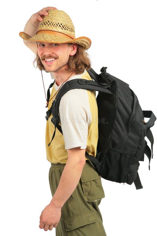 Viajero con el morral en sombrero de paja imagenes de archivo