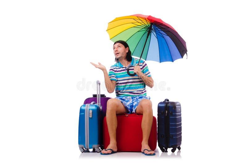 Viajero con los casos y paraguas aislado en imagenes de archivo