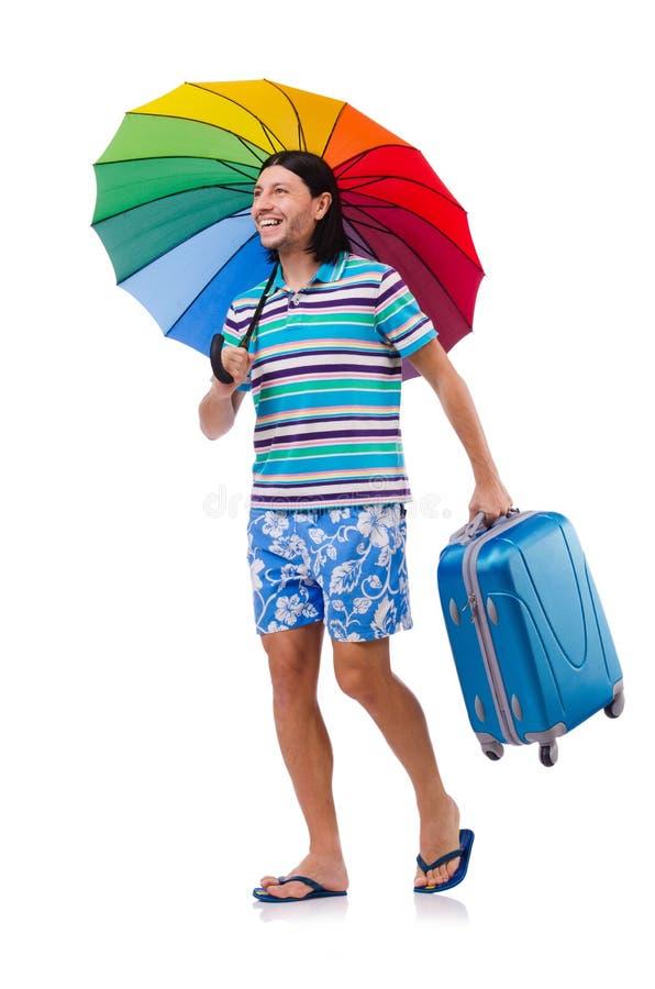 Viajero con los casos y paraguas aislado en blanco imagen de archivo