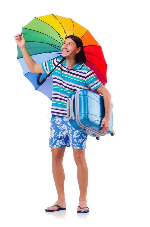 Viajero con los casos y paraguas aislado en blanco fotografía de archivo