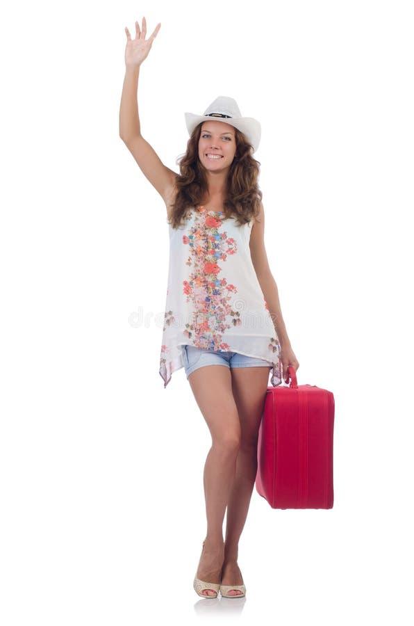 Viajero de la mujer con la maleta aislada imagen de archivo